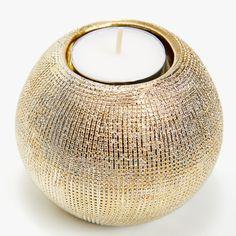 Scored ceramic tealight holder