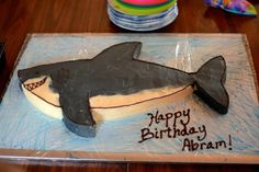 Shark birthday cake!  Super cute!  Luke wants it blue instead.