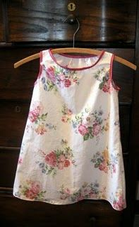 pillowcase nightgown ~ this reminds me of my sisters & myself as little girls, with mom on the sewing machine til the wee hours sewing us summer outfits.  :)