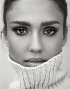 Actress Jessica Alba gets her closeup in a turtleneck sweater