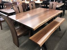 "48""x72"" Astoria Live Edge Table with Delphi Side chairs and 72"" Delphi Live edge bench. Shown in Rustic Walnut with a Natural Finish. One of a kind set!"