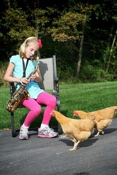 "This girl serenading her chickens with a beautiful jazz rendition of the Kanye West hit classic ""Gold Digger."""