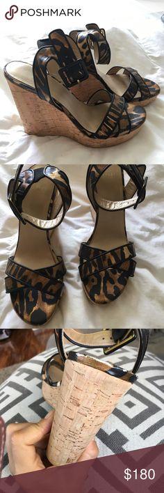 Stuart Weitzman wedges Leopard print. Worn less than 5 times. Slight scuffing on back of heel Stuart Weitzman Shoes Wedges