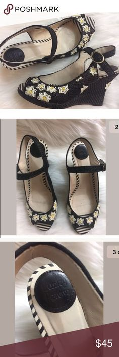 """Anthropologie Lucky Penny daisy wedges Gently used Lucky Penny open toe wedge heels, size 8.5. Raffia style black material with daisy pattern.   Heel-3.75"""" Anthropologie Shoes Wedges"""