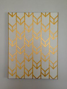 Spray paint the canvas one color, tape a pattern, paint another color, and then remove the tape. Perfect artwork!