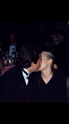 Story behind this shot is sweet. Photographer had a bad accident the day before waiting to take a picture of JFK Jr. He missed his opportunity. Photographer spotted John at the White House Correspondents dinner. John heard about the accident..when he saw the photographer approach him, he turned and kissed Carolyn so the photographer could get the shot. The photographer instantly was signed to an agency.
