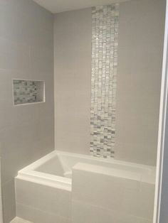 Shower completed! Strands Pearl with glass accents. Simply gorgeous.