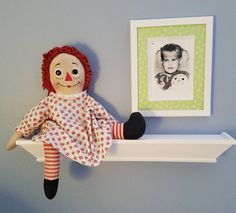 Visited my parents last week. My mom has this cute display of my old Raggedy Ann doll along with a picture of me holding it when I was a little girl.