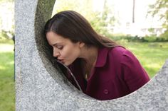 Woman drinking from Watering Holes drinking fountain in London's Green Park by Robin  Monotti Architects & Mark Titman