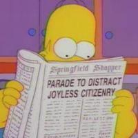 Simpson lendo jornal