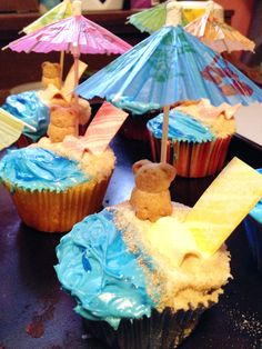 WE DID IT!!! We Made these super fun beach themed cupcakes based on the cute version we found on pintrest for a luau themed wedding shower (these were a group effort)