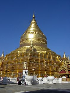 The Shwezigon Pagoda or Shwezigon Paya (Burmese: ရွှေစည်းခုံဘုရား) is a Buddhist temple located in Nyaung-U, a town near Bagan, in Burma (Myanmar). It is a prototype of Burmese stupas, and consists of a circular gold leaf-gilded stupa surrounded by smaller temples and shrines. Construction of the Shwezigon Pagoda began during the reign of King Anawrahta and was completed in 1102 AD, during the reign of King Kyansittha of the Pagan Dynasty