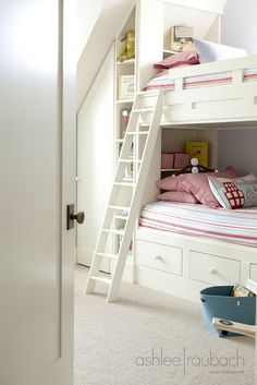 bunk beds and storage built-in to the knee wall