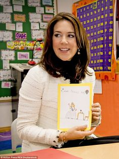 Princess Mary was later photographed beaming as she held up a small book with a hand-drawn...