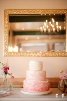 Ombre pink buttercream wedding cake. See our post on buttercream cakes at http://tulleandtwine.com/2013/9/3/beautiful-buttercream