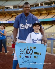 BTW, the kid in the photo above flew 3,000 mile to meet the Dodgers.  Who he is?  I haven't a clue.  Photo above via Jon SooHoo/LA Dodgers 2014.