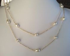 Hey, I found this really awesome Etsy listing at https://www.etsy.com/listing/90293572/pearl-long-necklace-teardrops-round