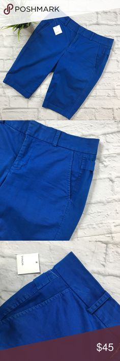 """VINCE Side Buckle Bermuda Short SZ 0 NWT VINCE Side Buckle Bermuda Short (B24) Royal Blue New With Tags(only Button hang Tag attached, not brand tag) Retail $195 •Vince stretch-twill pants with side buckles. •Flat front. •Four-pocket style. •Slim fit. •Tab/zip fly; belt loops. •98% Cotton/2% Spandex. Women's SZ 0 Measurements Laying Flat Waist 14.6"""" Rise 7.5"""" Inseam 11"""" Leg Cuff Opening 7"""" Vince Shorts Bermudas"""