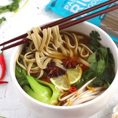 Add Lotus Foods Organic Pad Thai Rice Noodles to a pho soup bowl for a cozy, satisfying meal and know that you're supporting climate-friendly farming and preserving rice heritage! Recipe on our website!  #soup #pho Ramen Noodle Bowl, Rice Noodle Soups, Pad Thai Rice Noodles, Food Inc, Asian Recipes, Ethnic Recipes, Food Website, Pho, Vegan