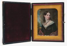 "Lot 37: 19th C. Miniature Portrait  Young lady with blue eyes, in a black dress with white lace, tartan shawl, black ribbon necklace, gold necklace attached to a cameo brooch, landscape in the background, signed near the left shoulder ""G L Saunders 1845″ (1774-1846), found in the church rectory in Stockbridge, MA, piece comes with detailed provenance of artist and names the subject as Susan Coombs Dana, born July 16, 1817, in a closed wooden frame, 4 1/4″ x 3 1/4″ (sight), 5 1/2″ x 4 1/2″…"