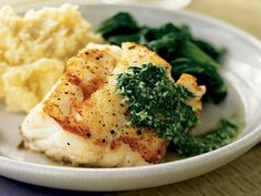 Pan-Seared Cod with Basil Sauce | This versatile fish delights whether dipped in batter or lightly seared. Try it in one of these healthy cod recipes.