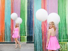Colorful. Paint wall. Biscuit Paint Wall. Balloons. White. Pink. Dress. Stratford high senior high school pictures by Joie Photographie top Houston senior photographer joy photography creative fun photo ideas