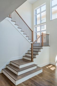 Open entry with white oak hardwood flooring and hardwood stair treads. Hardwood…