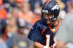 peyton manning training camp 2013 | Peyton Manning runs through drills during opening day of training camp ...