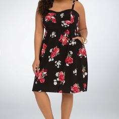 NWT Torrid spring flower dress Adorable black spring dress by torrid accentuated with red and cream painted roses. Elastic cinched band under bust. So cute! torrid Dresses Midi