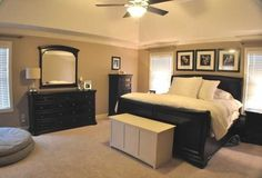 Master bedroom with black and tan color palette. Like this, but Id probably add a pop of color!