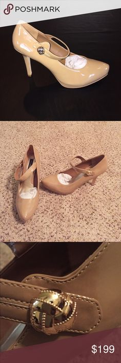 """White House Black Market Nude Mary Jane Pumps Beautiful dark nude Patent Leather Mary Jane Style Heels. 4"""" heels with .5"""" hidden platforms. Snap closure on straps. Gold button decoration. 'Shayla' Style. So versatile. Adds class to any outfit. White House Black Market Shoes Heels"""