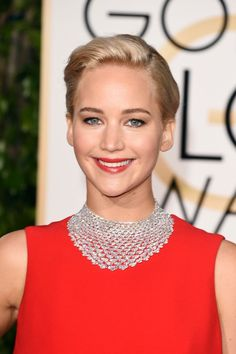 Jennifer Lawrence has never met a red carpet she couldn't win, and tonight was no exception. Her platinum lob was twisted into a textured updo with just a touch of volume at the roots, while her makeup was paired down and coordinated to her red dress.  #refinery29 http://www.refinery29.com/2016/01/100905/golden-globes-2016-best-hair-makeup#slide-22