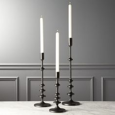 Shop Allis Black Taper Candle Holders.   Sleek aluminum finished with black powdercoating for smooth matte feel (not too shiny, not too flat).  Pair with white taper candle (sold separately) for max contrast.