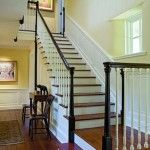 I really love the painted risers, the stained treads, and the black rail!  Also, the wainscoting (?) going up the stairs!