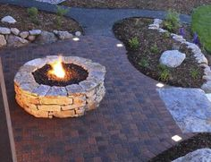 How to Make a Fire Pit  Warm up to the idea of a simple, stacked-stone fire pit with this easy project.