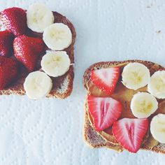 Ezekiel toast with almond butter, peanut butter, strawberries, and banana.