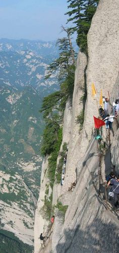 "Mountain in China called Mt. Hua Shan. At its base, you'll find a gigantic set of stone stairs, called ""the Heavenly Stairs."" The stairs lead to the world's most dangerous trail, the Hua Shan plank path. The plank trail leads high up the Hua Shan mountain just outside the city Xi'an. At the very top of the southern peak is a Taoist temple that was converted into a teahouse."