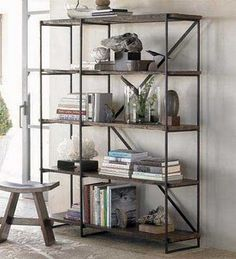 cool bookcase built out of plumbing pipe and reclaimed wood
