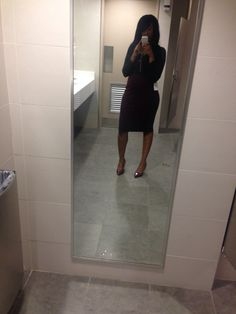 Office attire: Burgundy heels and skirt and black top