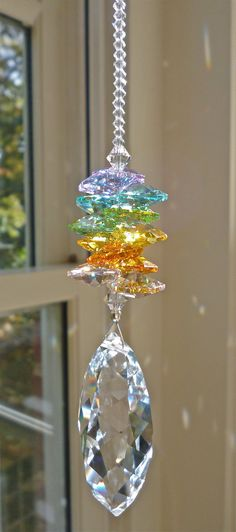 "Summer   10 Swarosvki Crystal Suncatcher by HeartstringsByMorgan, $33.00.  (Large pendant and pastel octagons are Swarovski Strass (lead crystal = most ""rainbow"" light dispersion); therest are Sarovski clear;  SS crimps and nylon-coated stainless steel wire for durability.  10 1/2"" length.)"