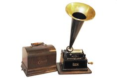 """1905 Edison """"GEM"""" model """"A"""" cylinder phonograph with original oak base and oak cover and decals. The cone is exact replica. The phonograph plays two minute cylinders. The GEM was created by Thomas Edison and sold for ten dollars,"""