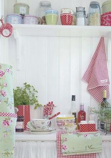 Homespun florals, linen and gingham patterns make for a sweet country kitchen.