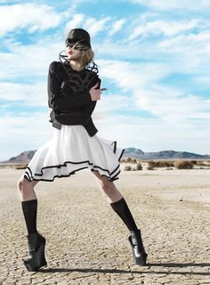L'une Collection corset top and black widow hat in Runway Magazine. Photo by Tracey Morris, styled by Rafael Linareas.