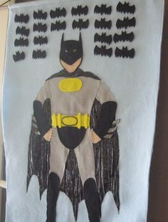 pin the logo on batman's chest. i like the idea of using felt instead of paper.