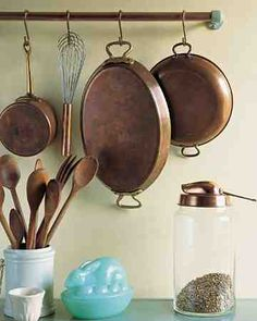 Their sleek glass and porcelain rods long gone, enameled, ceramic, and metal towel-bar supports often turn up at flea markets. Attractive -- but what can you do with them? Show off the hardware in another room. Coordinate a pair of the supports with your kitchen's color scheme or style, and suspend copper pipe from which to hang pots and pans.