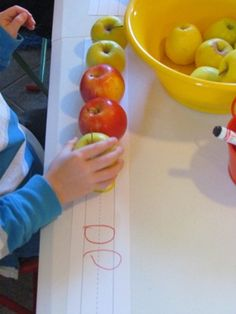 Making apple patterns in preschool. Great, hands-on way to teach children about patterns by Teach Preschool.