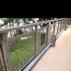 combining reclaimed wood with glass for railing