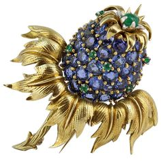 Schlumberger Blue Sapphire Thistle Pin | From a unique collection of vintage brooches at https://www.1stdibs.com/jewelry/brooches/brooches/