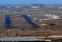 Aerial view of the desert nature of the land surrounding the South Airport of Tenerife known as Reina Sofia (TFS).
