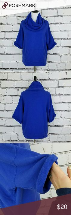 J. Crew Oversized Cowl Neck Sweatshirt! Blue cowl neck sweatshirt. Large front pockets. Rolled short sleeves. Oversized fit. Soft 100% cotton. Length is about 24 inches and armpit to armpit is about 24 inches. Great condition! J. Crew Tops Sweatshirts & Hoodies